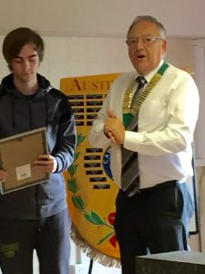 Adam receiving his Regional Young Achievers award from the Club's Chairman Mel Hill